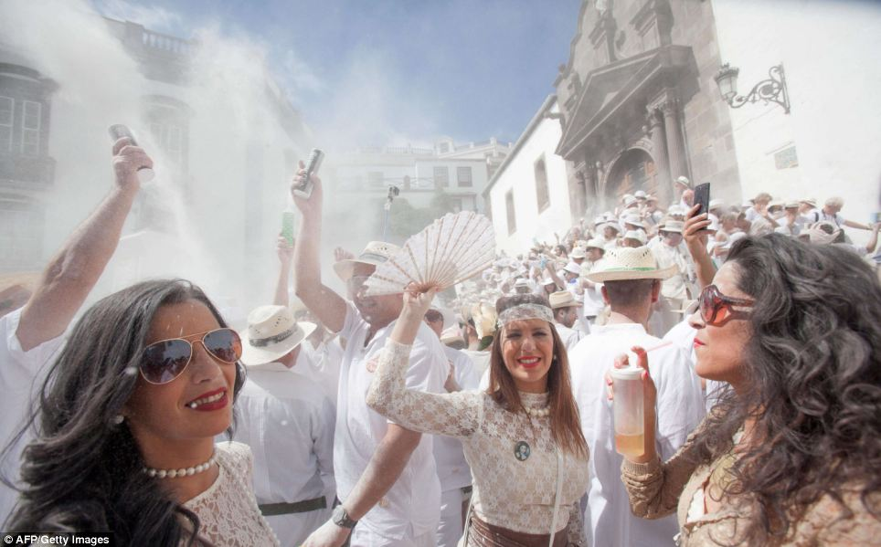 Revellers known as 'Los Indianos', throw talcum powder over each other during carnival. Something you should definitely not do.